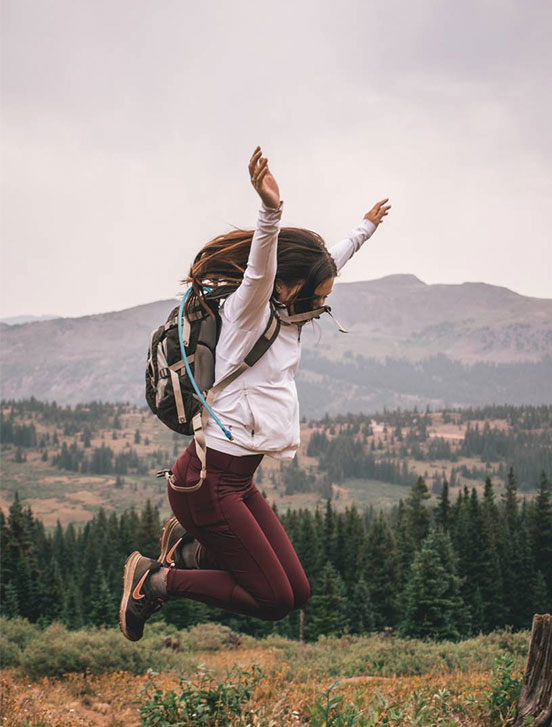 A girl jumping in nature