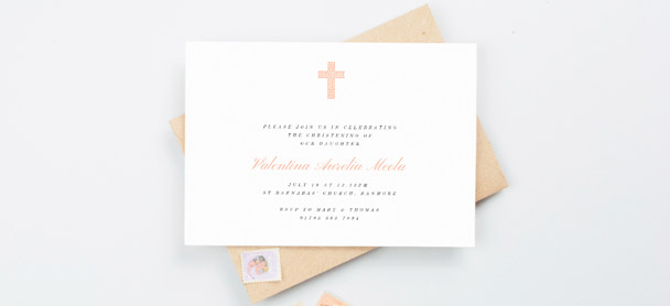 A religious christening invitation. This is a landscape christening invite card with a light orange, modern crucifix design.