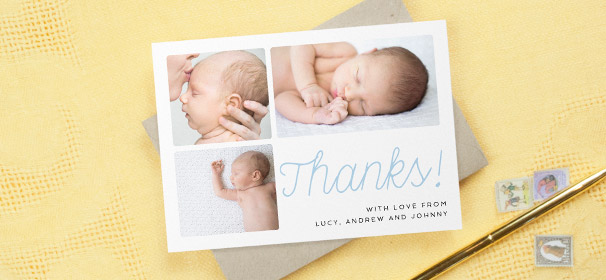 "A modern christening thank you card with photos. The card has 3 photos of a baby boy with ""Thanks!"" written in a handwritten, blue font."