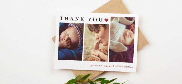 A christening thank you card with photos. The christening thank you card is printed with 3 portrait baby photos and cute red heart design.