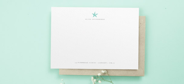 A personalised correspondence card for women. It is a traditional white note card printed with a name, address and simple green star motif.
