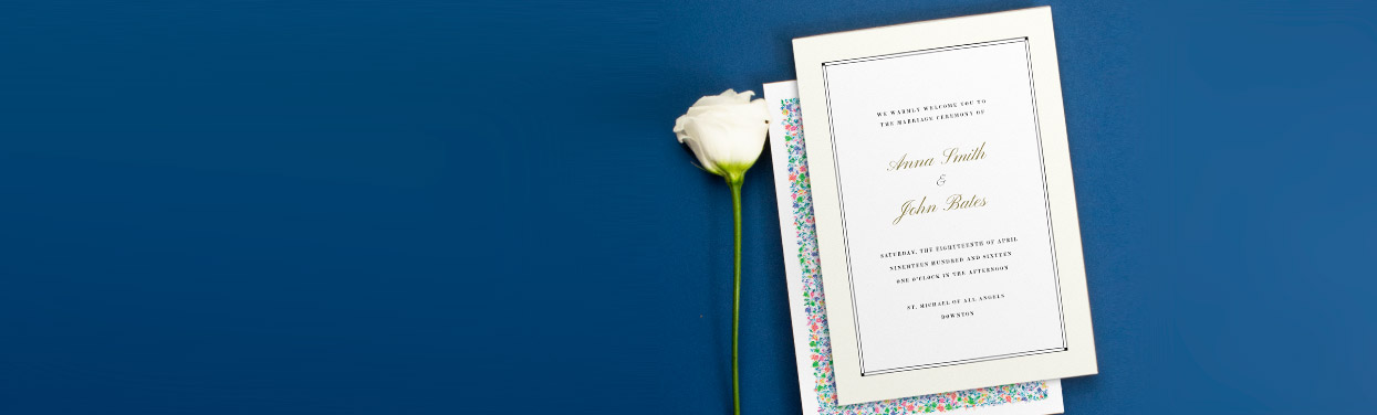 Two wedding order of service designs. A traditional, cream booklet sits on top of a floral wedding order of service design.