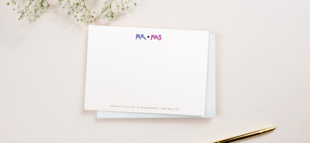 "A personalised desk stationery card for couples. The note card is printed with ""Mr and Mrs"" at the top, with an address at the bottom."