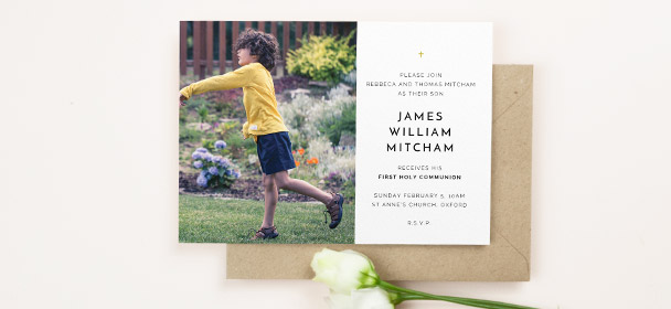 A first holy communion invitation card. The religious card design is printed with a photo of a boy. It has has traditional communion invite text.