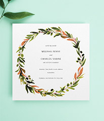 A floral save the date card design for a wedding. It is a square save the date with a flower wreath border. It is a watercolour painted design.
