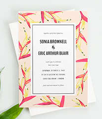A floral wedding invitation card design. It is a modern floral wedding invitation with a pink bird of paradise border and striking typography.
