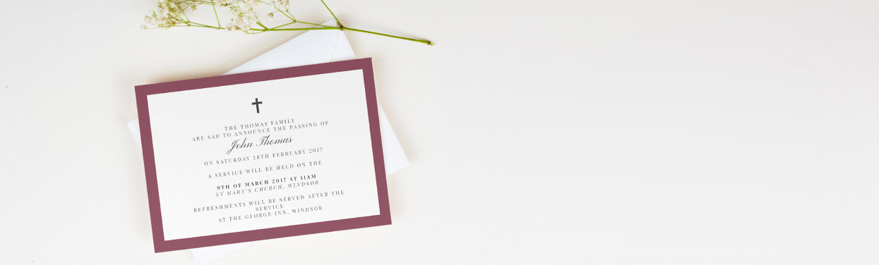 A classic and elegant funeral announcement card. The invite is printed with a black crucifix and a thick maroon border.