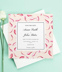 A modern wedding save the date card design with beautiful falling petals. The card is pink and peach with a white centre.