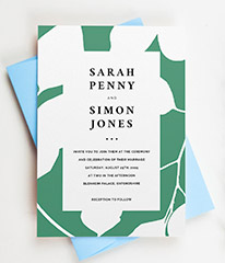 A personalised modern wedding invitation design. The wedding invite has a green and white floral motif and modern, black typography.