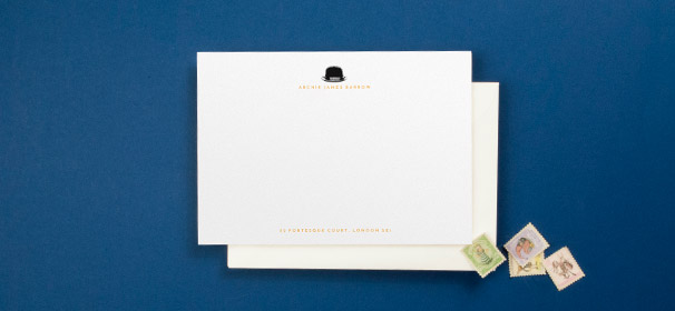 A personalised note card designed for a man. It has a black bowler hat icon at the top of the card, and the gentleman's name and address in orange.