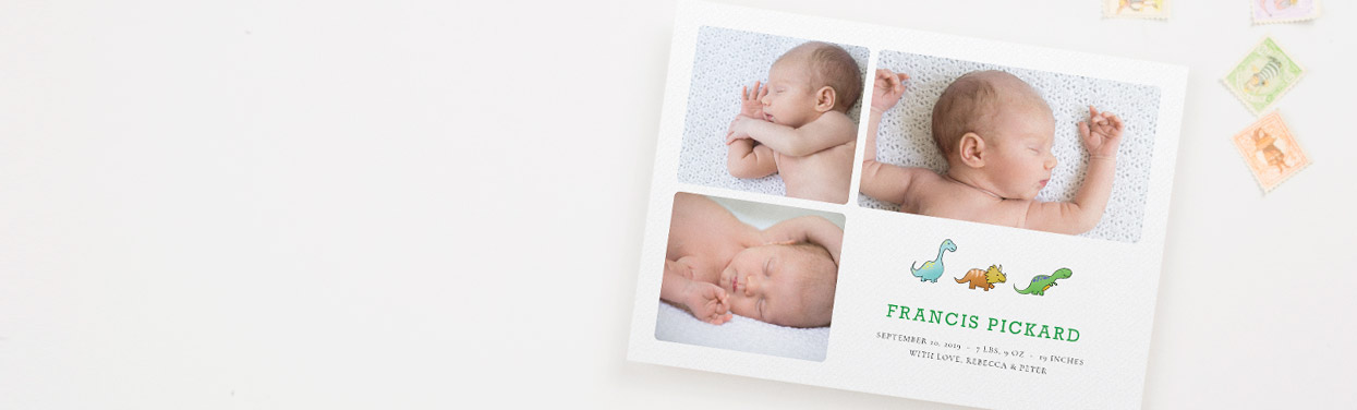 A printed, personalised baby birth announcement card. The stationery card has 3 photos of a new-born baby, and a cute dinosaur design.