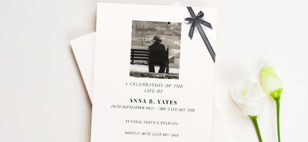 An 8-page funeral order of service booklet. This funeral service program has a photo of the loved one at the top, and a printed black ribbon.
