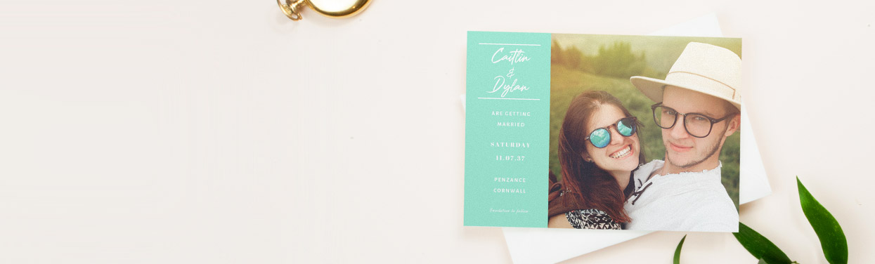 A personalised wedding save the date card with a photo. The save the date design is printed with a large photo of a couple.