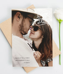"""A wedding save the date card with photos. The save the date card has a full page photo, and """"Save the date"""" is written in the top right-hand corner."""