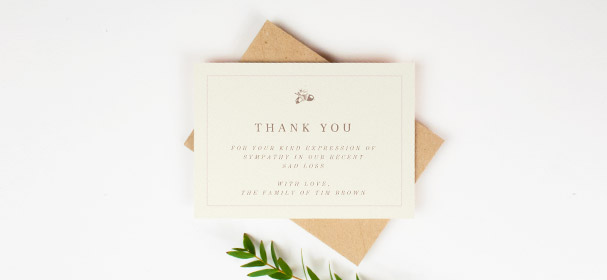 A funeral thank you card with a classic golden orange border. The card has an oak tree motif at the top and message of thanks from the family.