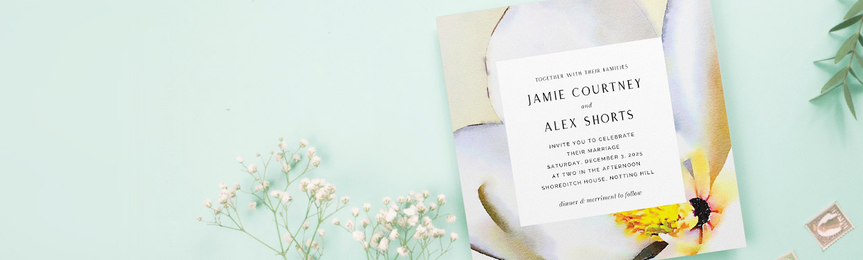 A square, printed wedding invitation. The personalised wedding invite has a modern, floral design. The card includes the wedding details.