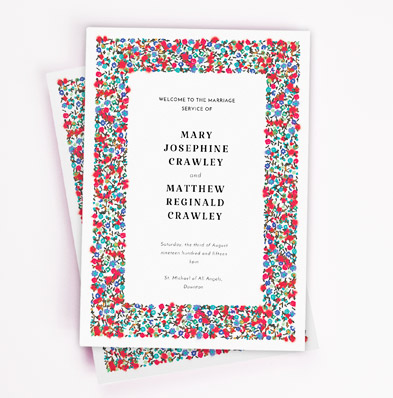 A floral wedding order of service design. It is traditional wedding program booklet with a red and blue flower border.