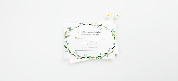 A matching wedding RSVP card with a cute floral design. The response card is printed with spaces where wedding guests can write their attendance.