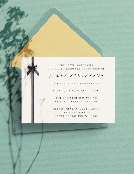 A simple funeral announcement card design. The funeral invitation is printed with a serif font, black ribbon and bow motif down the left of the card.