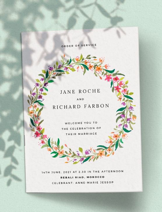 An A5 printed wedding order of service. It is a traditional wedding program booklet with a simple cream and black border. It has a gold font.