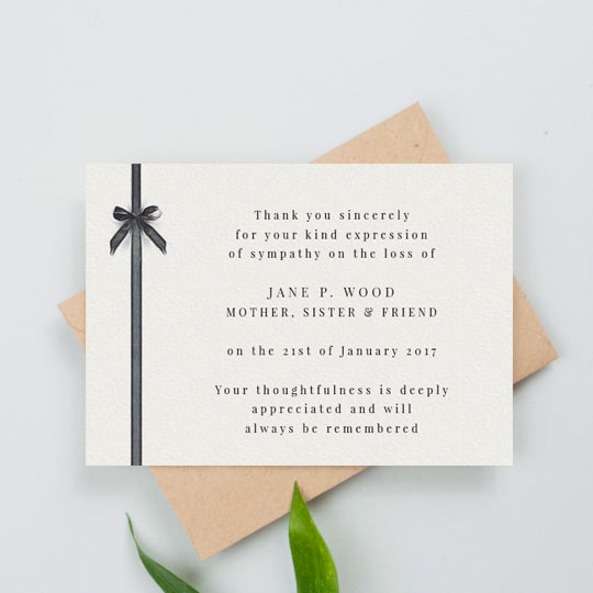 A classic funeral thank you card. The card is landscape with a painted black ribbon running down the left-hand side. The rest of the funeral thank you card has a personalise, printed message of thanks in a smart, black font.