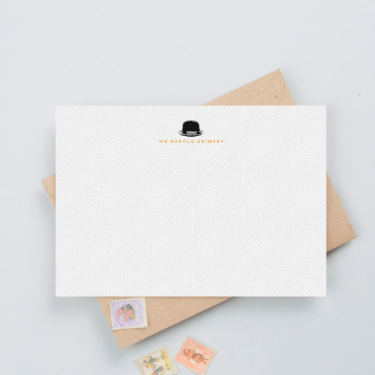 A man's personalised note card with a black bowler hat printed at the top. It has a gentleman's name printed underneath.