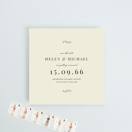 A vintage, square wedding save the date card. The card has a cream background with gold flourished at the top and bottom. This save the date has an art deco feel to it.