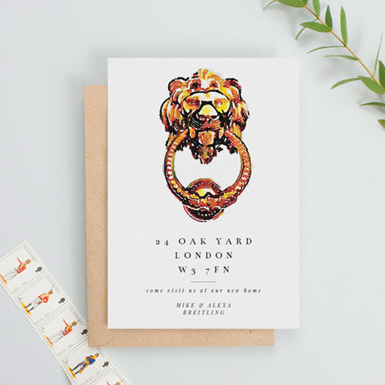 A moving home card in portrait orientation. It has a large, painted bras door knocker in the shape of a lion. Underneath is a new address and a personalised message of thanks