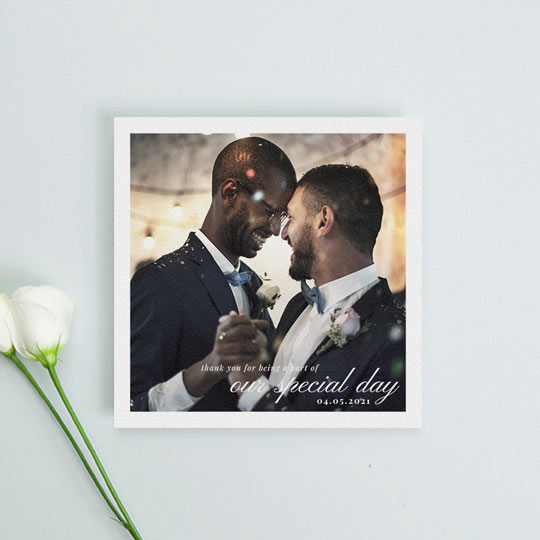 "A square, simple wedding thank you card with photos. The words ""our special day"" are spelled out in a script font along with the name of the married couple and the date of their wedding. It is a white font."