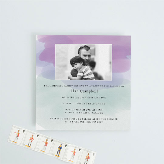 Modern funeral announcement card with watercolour-effect swathes of colour, mainly purple, green and blue. It has a photo in black and white of the deceased and details of a funeral service below.