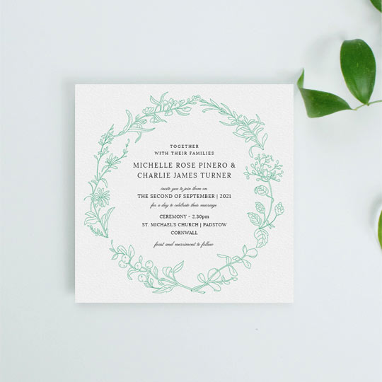 This wedding invitation design had the hand drawn outline of green botanical plants. The border is minimalist and modern, with classic wedding invitation text in the centre of the card.