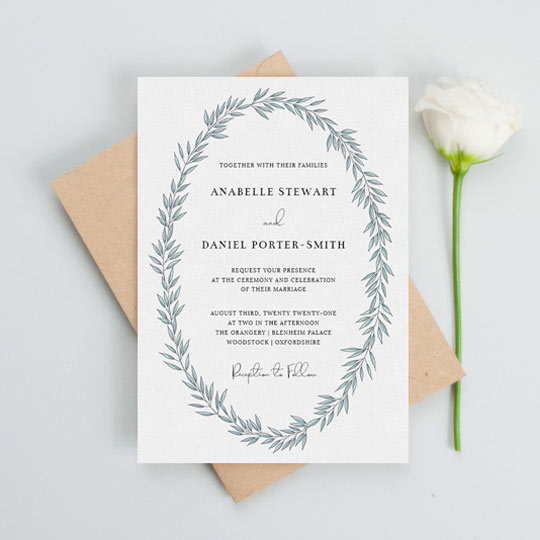 A modern floral wedding invitation design with a light blue abstract wreath on a white background. The wedding invitation's text is printed in black.