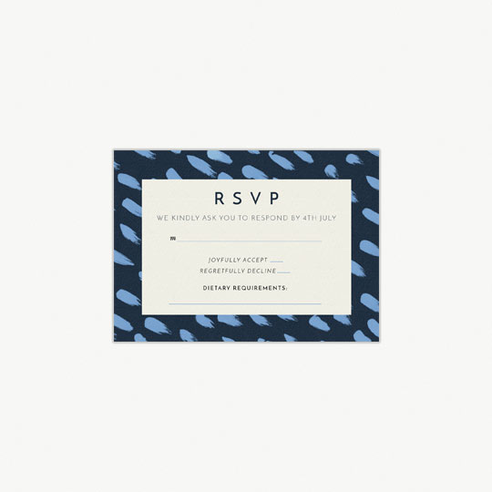 A modern, blue and white wedding response card. It has RSVP printed at the top of the card. The border is navy blue, with light blue daubs of paint running diagonally.