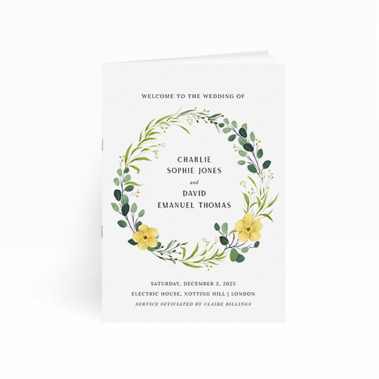 This wedding order of service booklet has multiple pages. The front cover has a floral wreath and surrounds the names of the bride and groom. The details of the wedding service are printed at the bottom of the order of service cover.