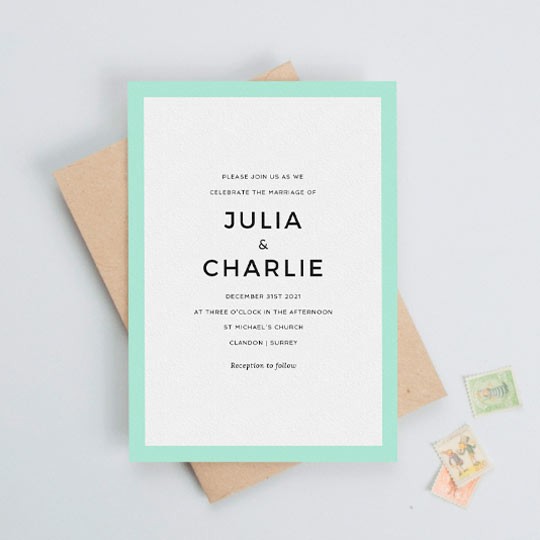 A modern and simple wedding invitation card design with a bold, mint blue border. The wedding invitation has a lot of white space around some centralised wedding invite text in a bold, sans-serif font.