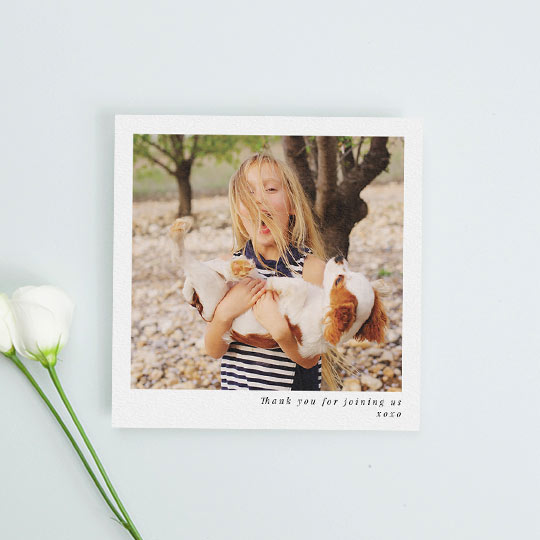 "A very simple, square communion thank you card. It has a central, large photo of a young girl, with a message underneath that reads ""Thank you for joining us xoxo"""