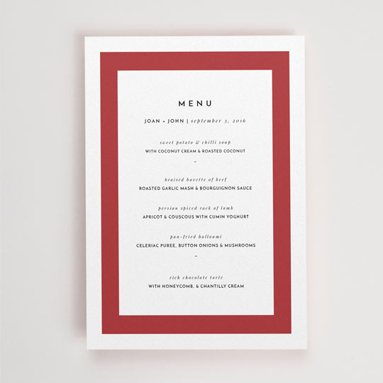 "An A5, white wedding menu with a thick, bold, red border. ""Menu"" is printed at the top of the menu card and the courses of food follow underneath."