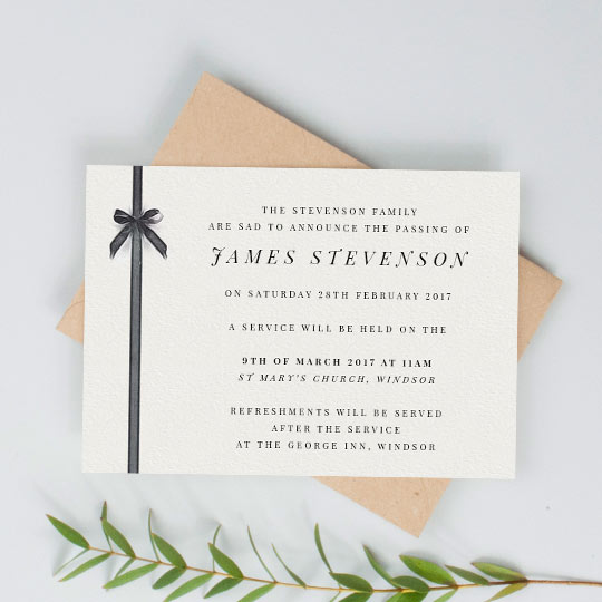 A classic, landscape funeral invitation card. It has a painted black ribbon running down the left-hand side. The details of a funeral are printed on the right-hand side of the card.