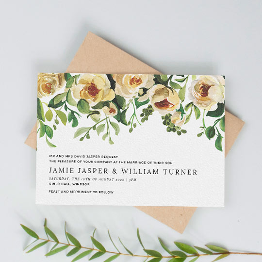 A vintage, landscape wedding invitation design. The top half of the card is filled with a beautifully painted rose bush. Underneath, black wedding invitation text sits to the left of the card.
