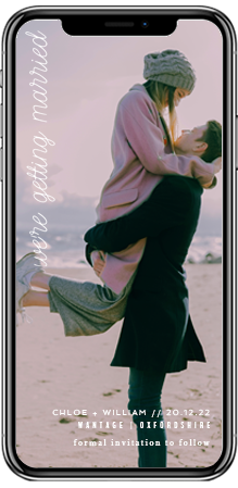Full page wedding save the date card on a smartphone screen. It is of an engaged couple hugging.