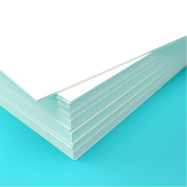 A stack of 350gsm card used for stationer printing