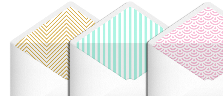 Three premium stationery envelopes sitting side-by-side. They have a colourful, patterned lining.