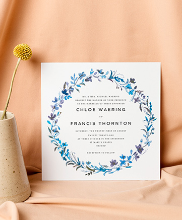 A watercolour wedding invitation named