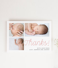 "A modern baby thank you card design with 3 baby photos on it. The printed baby card has the word ""Thanks!"" in cursive script."