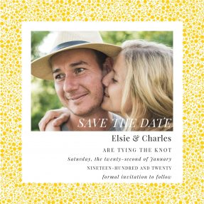 A floral save the date design made up of yellow flowers around a rectangular photo frame.