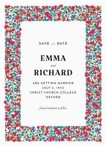 A floral save the date design with a predominantly red and blue, smudged floral border.