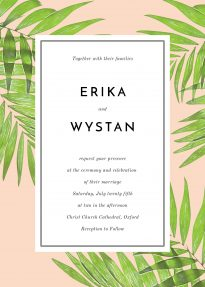 The wedding invitation is comprised of tropical green palm leaves on a peach background. The typography of the invites is clean and modern.