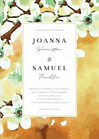 A portrait printed wedding invitation with an autumnal, watercolour blossom border