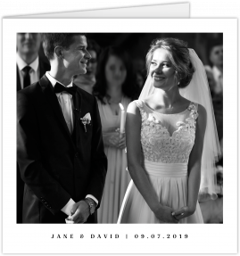 A square photo wedding thank you card with a black and white photo of a couple stood at a church altar