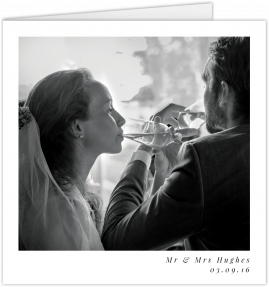 A simple wedding thank you card with a black and white photo in the middle. It is a square thank you card.